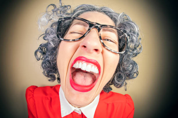 Funny Fisheye Nerdy Older Woman Laughing A humorous fisheye image of an older, nerdy woman laughing out loud. sdominick stock pictures, royalty-free photos & images