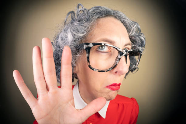 Funny Fisheye Nerdy Older Woman Saying Talk to the Hand A humorous fisheye image of an older, nerdy woman saying talk to the hand. sdominick stock pictures, royalty-free photos & images