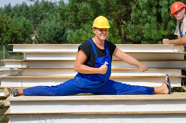 Best Construction Worker Stretching Stock Photos, Pictures & Royalty