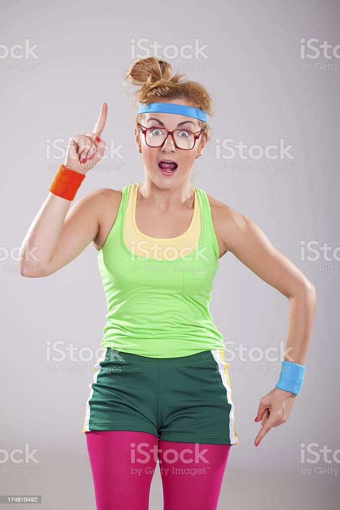 Funny fitness girl wearing glasses making surprised face royalty-free stock photo