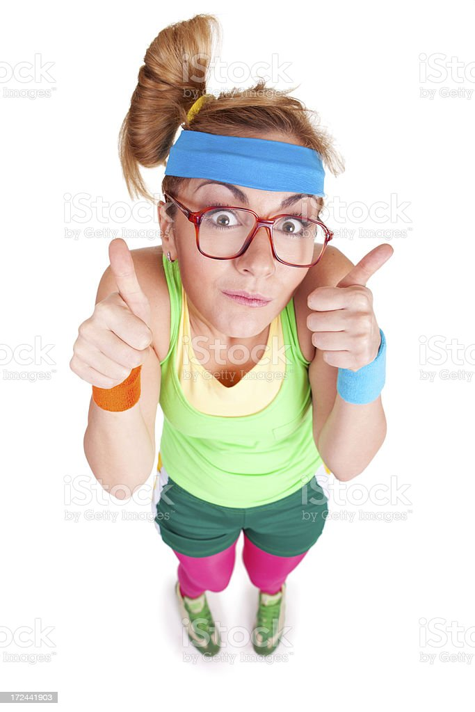 Funny fitness girl with glasses gesturing with her thumbs up royalty-free stock photo