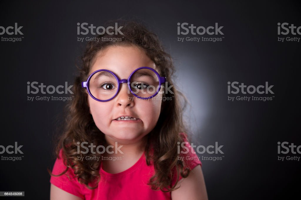 Funny five years girl making faces royalty-free stock photo