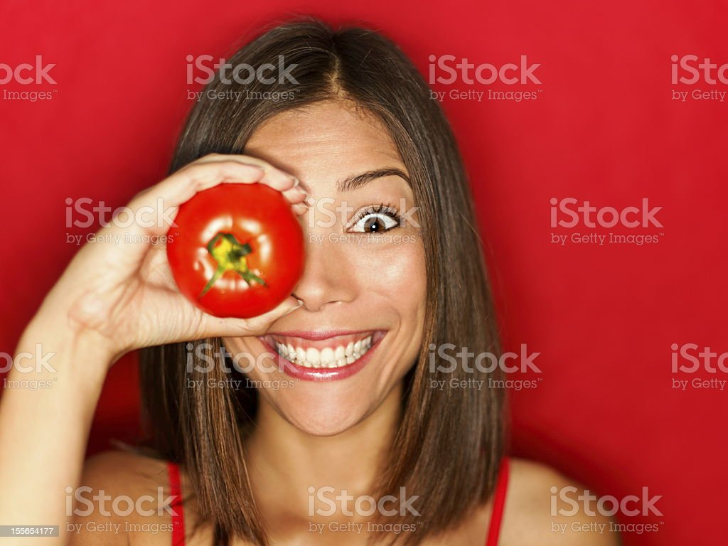 Funny food woman with red tomato royalty-free stock photo