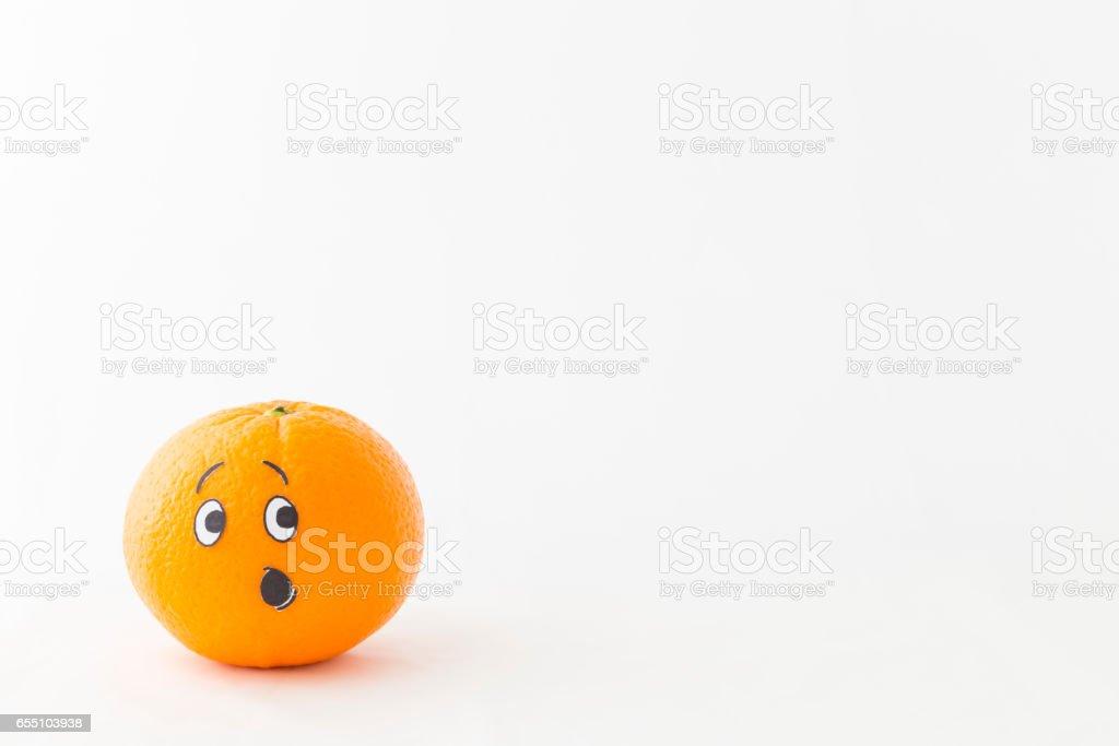 Funny fresh orange with astonished face stock photo