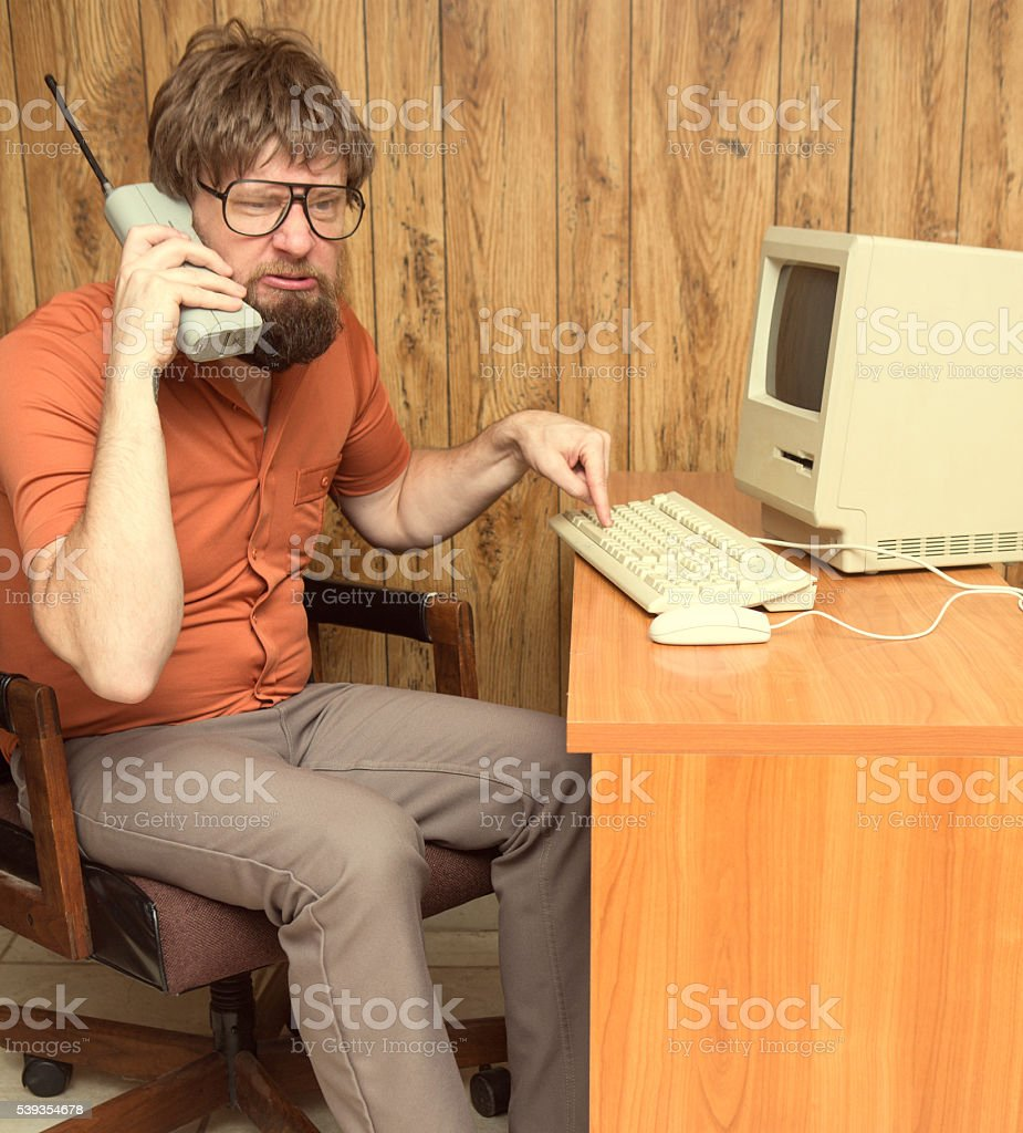 funny frustrated 1980s nerd computer man stock photo
