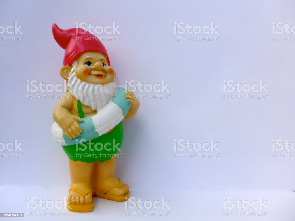 Funny garden dwarf makes seaside holiday royalty-free stock photo