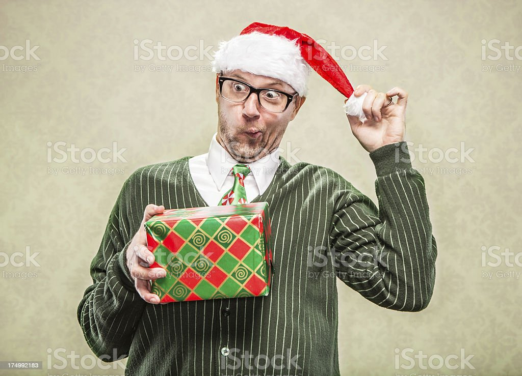 Funny Gift Exchange for the Holidays Man in Santa Hat stock photo