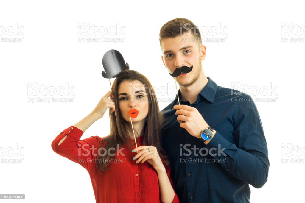 funny girl and the guy holding the paper dummies and photographed isolated on a white background stock photo