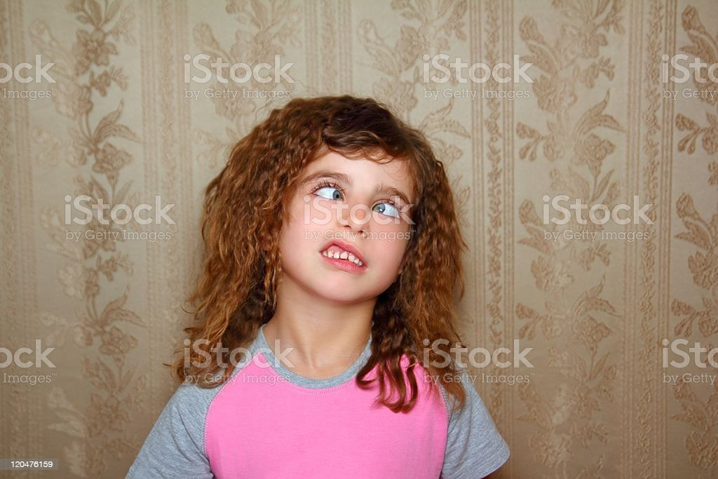 funny girl face ugly expression cross-eyed squinting stock photo