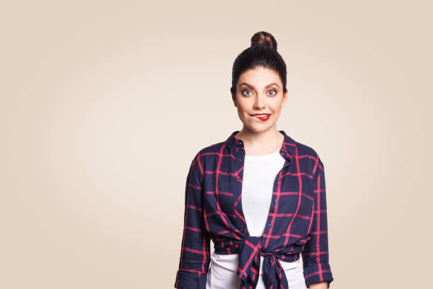 funny girl in casual style looking at camera with big eyes and biting lips stock photo