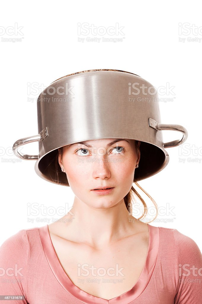 350faa8c695a Funny girl portrait wearing pot as hat and looking upwards royalty-free  stock photo
