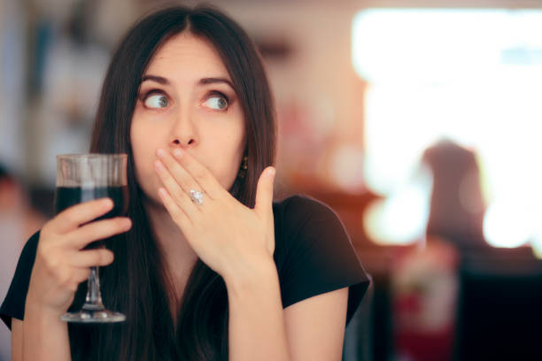Funny Girl Reacting after Drinking Frizzy Soda Drink stock photo