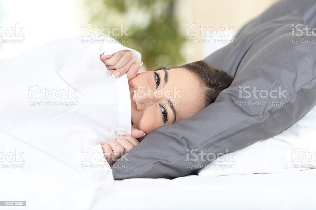 Funny girl resting on a bed stock photo