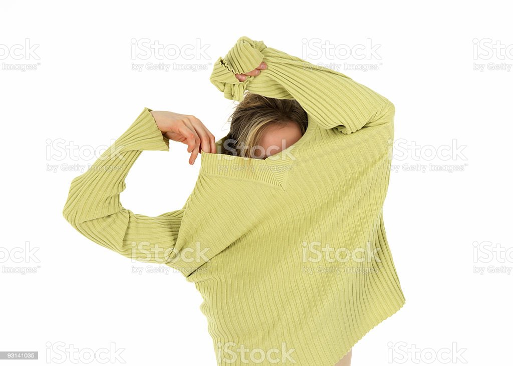 Funny girl takes off a green sweater stock photo