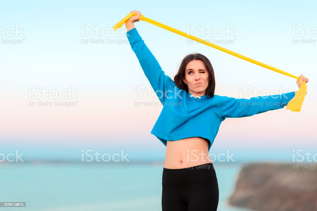 Funny Girl Trying to Work out with Yoga Band stock photo