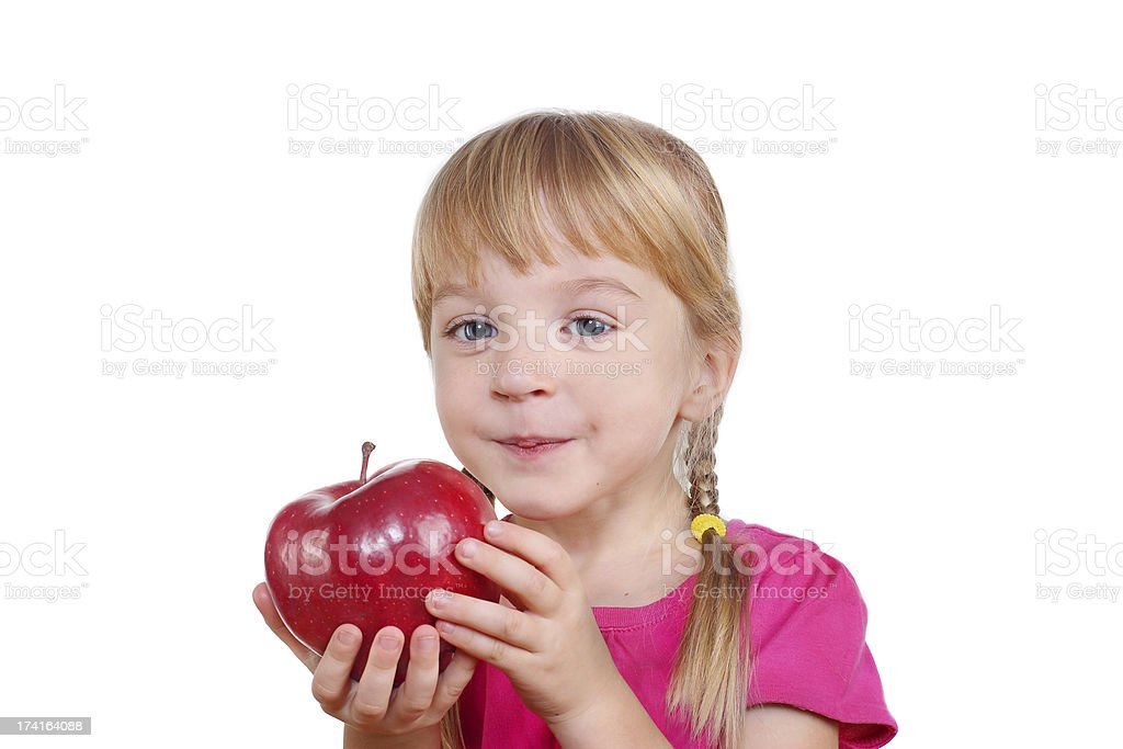 funny girl with apple royalty-free stock photo