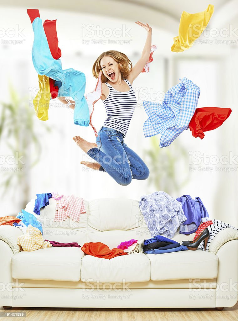 Funny girl with flying clothes jumping at home royalty-free stock photo