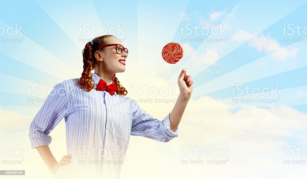 Funny girl with lollipop royalty-free stock photo