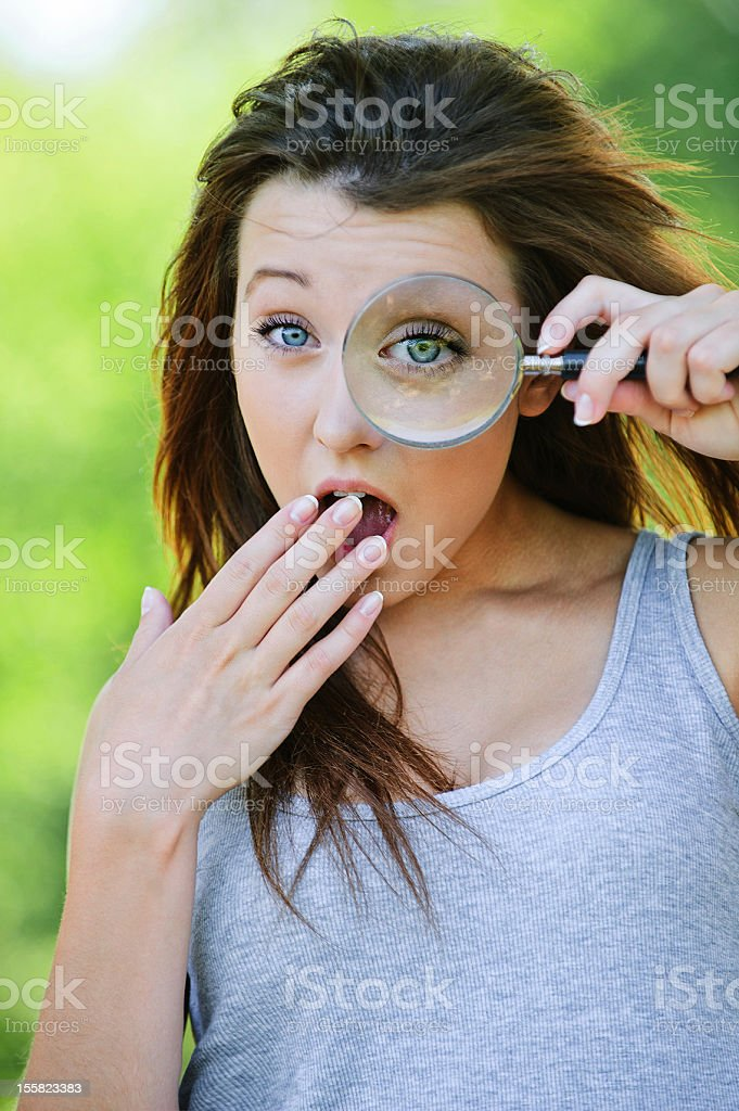 funny girl with loupe royalty-free stock photo