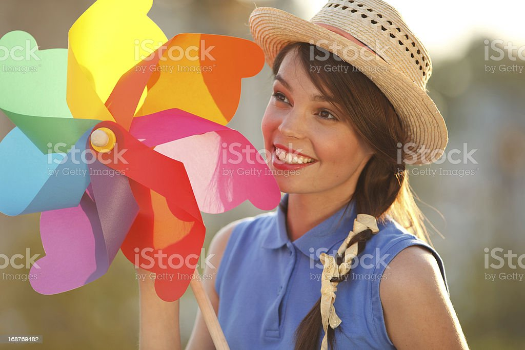 Funny girl with weather vane royalty-free stock photo