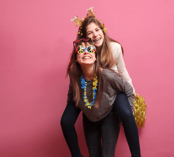 Funny girls in a Photo Booth party stock photo
