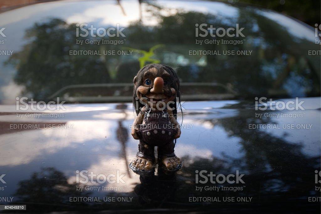 Funny Gnome Figurine Car Hood Ornament stock photo