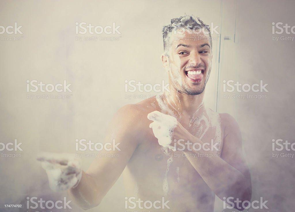 Funny guy under shower. stock photo