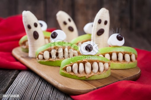 istock Funny halloween eadible monsters scary food healthy vegetarian snack dessert 492704608