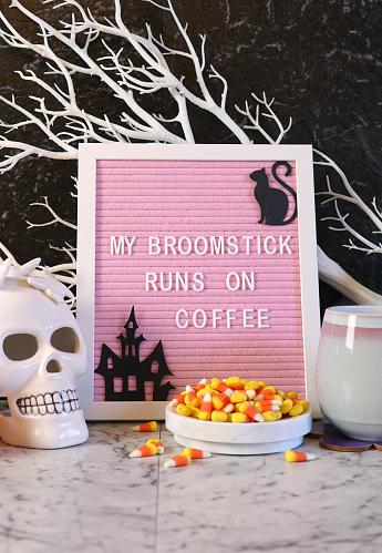 istock Funny Halloween My Broomstick Runs on Coffee letter board. 1176687114