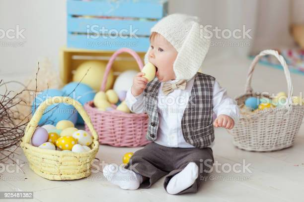 Funny happy baby boy in bunny hat tie bow and suit playing with eggs picture id925481382?b=1&k=6&m=925481382&s=612x612&h=gmonbifu4jecjbi6nravrbxp15rabebys2qf3nli174=
