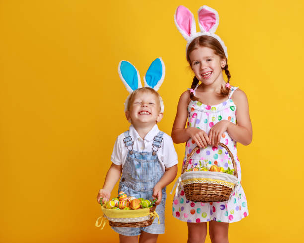 Funny happy child boy and girl with easter eggs and bunny ears on picture id1133444102?b=1&k=6&m=1133444102&s=612x612&w=0&h=jqilg 2cihnkkpxhrlaamcuhnytjh9nbx0bsn1w 1c0=