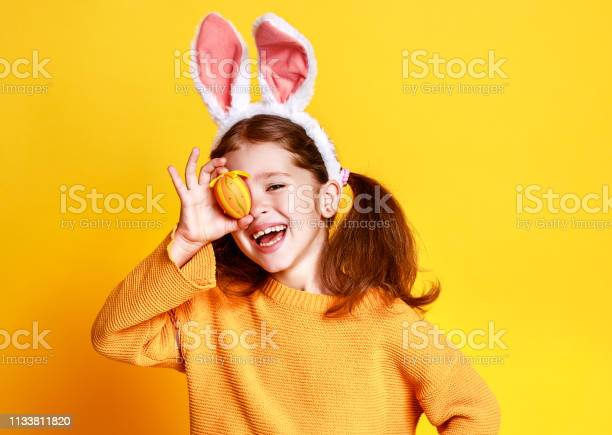 Funny happy child girl with easter eggs and bunny ears on yellow picture id1133811820?b=1&k=6&m=1133811820&s=612x612&h=jzcfgv3hv9na58dd3ltng9zfednwzi7cl9eq3r3aqz8=