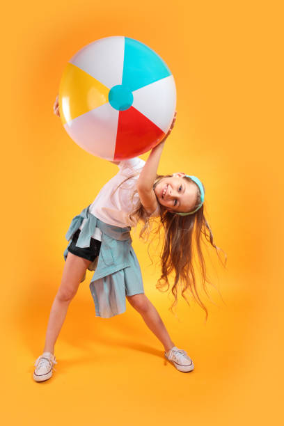 Funny happy child in summer clothes jumping with beachball on colored picture id1222647452?b=1&k=6&m=1222647452&s=612x612&w=0&h=lj0 rziegqxnuydeqt8jxqf4ikun1hzbk3ocqgmtkgw=