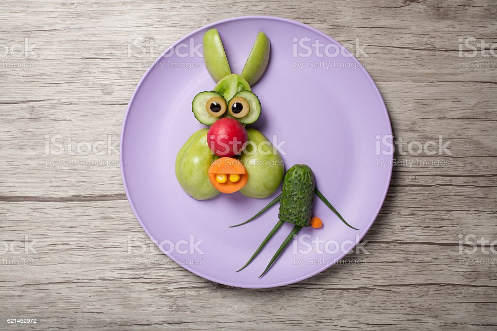Funny hare made of green vegetables on plate and board photo libre de droits