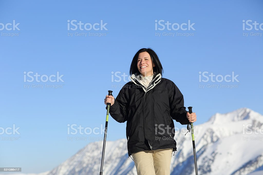 Funny hiker woman trekking in the mountain stock photo