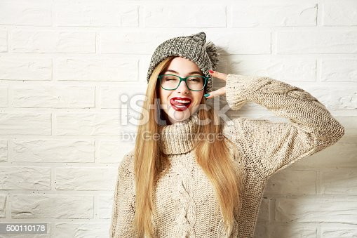 istock Funny Hipster Girl in Winter Clothes Going Crazy 500110178