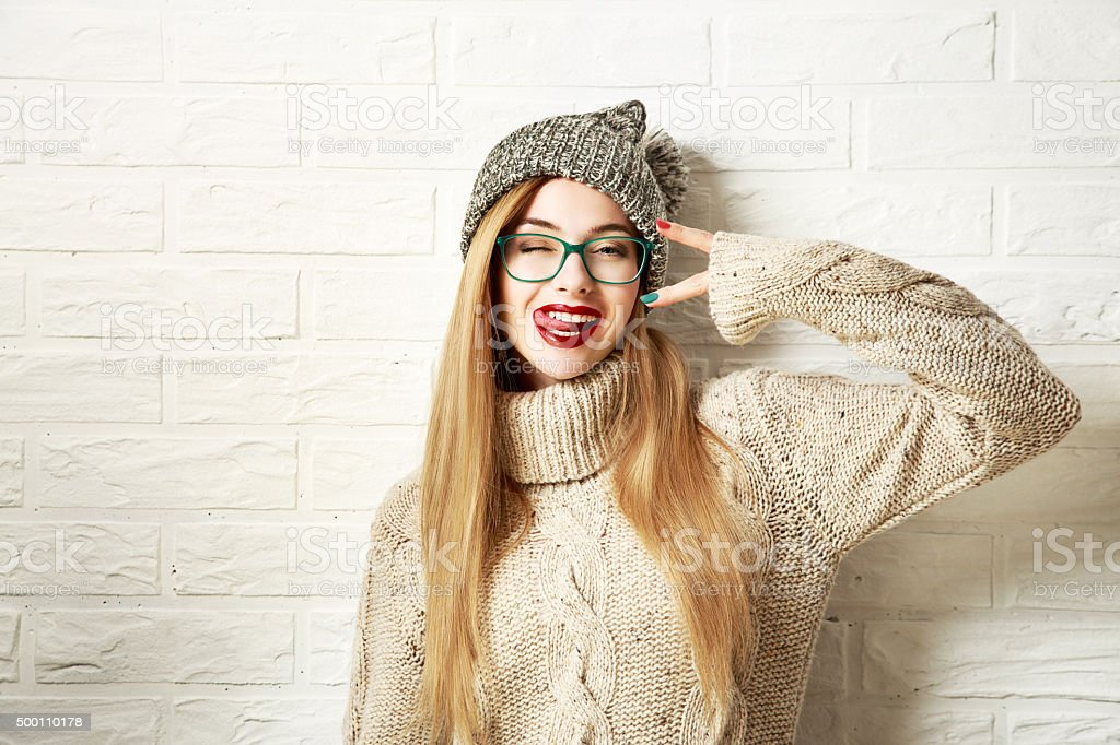 Funny Hipster Girl in Winter Clothes Going Crazy stock photo