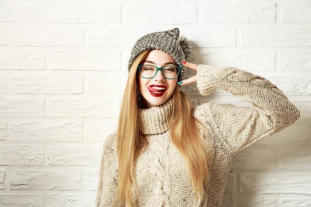 funny hipster girl in winter clothes going crazy - hipster fashion stock photos and pictures