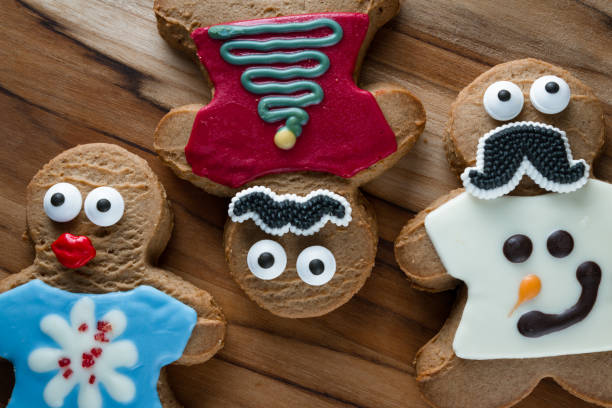 funny holiday cookies - ugly sweater stock pictures, royalty-free photos & images