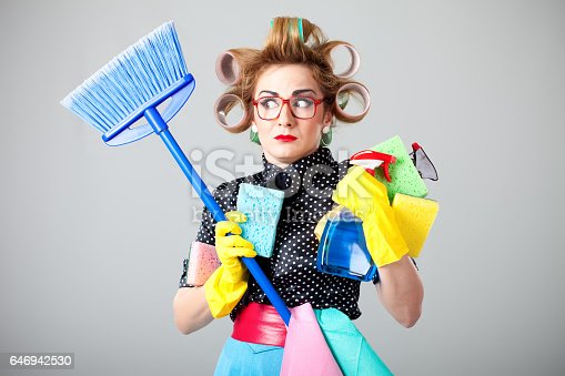 istock Funny housewife cleaning 646942530