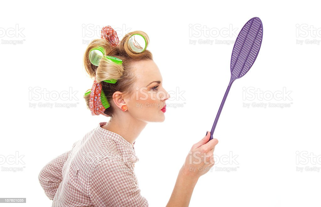 Funny housewife / girl with fly swatter, isolated on white stock photo