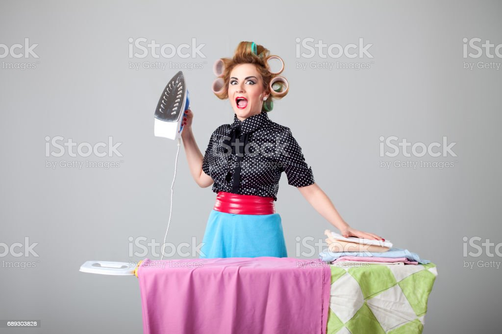 Funny housewife ironing stock photo