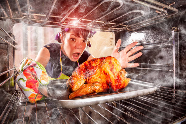 funny housewife perplexed and angry. loser is destiny! - burned oven imagens e fotografias de stock