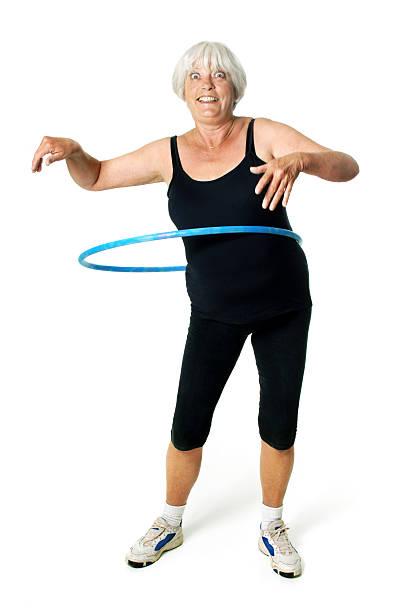 lustiger hulla hoop - hula hoop workout stock-fotos und bilder