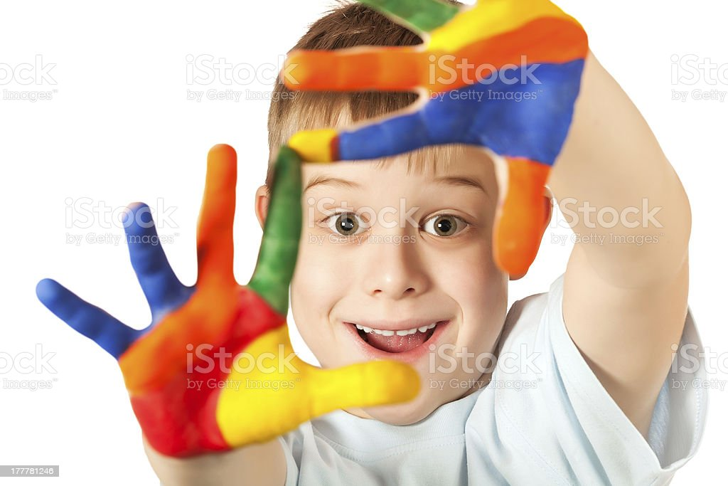 funny kid with stained coloured hand stock photo