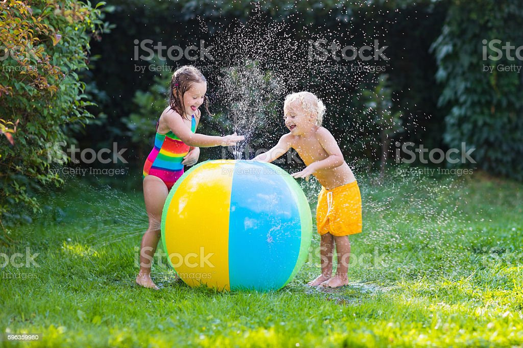 Funny kids playing with water ball toy royalty-free stock photo