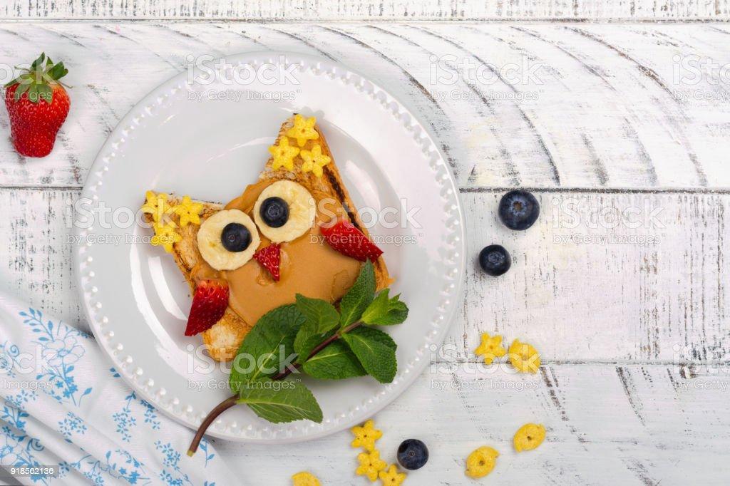 Funny kids sandwich. Tasty owl sandwich for school lunch or breakfast stock photo