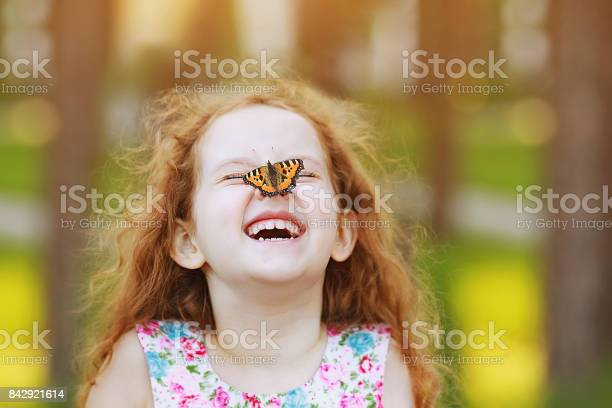 Funny laughing curly girl with a butterfly on his nose picture id842921614?b=1&k=6&m=842921614&s=612x612&h=zmwe8e 1l611smpg4mdp5q01pnfvpkinmr84deyvtf8=