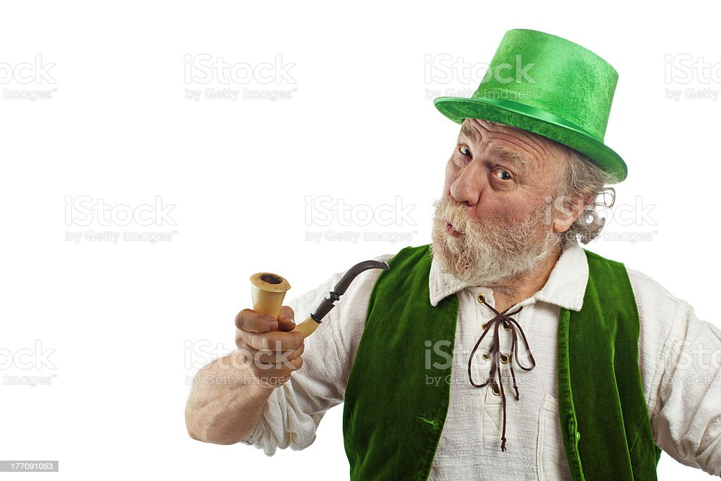 Funny leprechaun with pursed lips holding a pipe stock photo