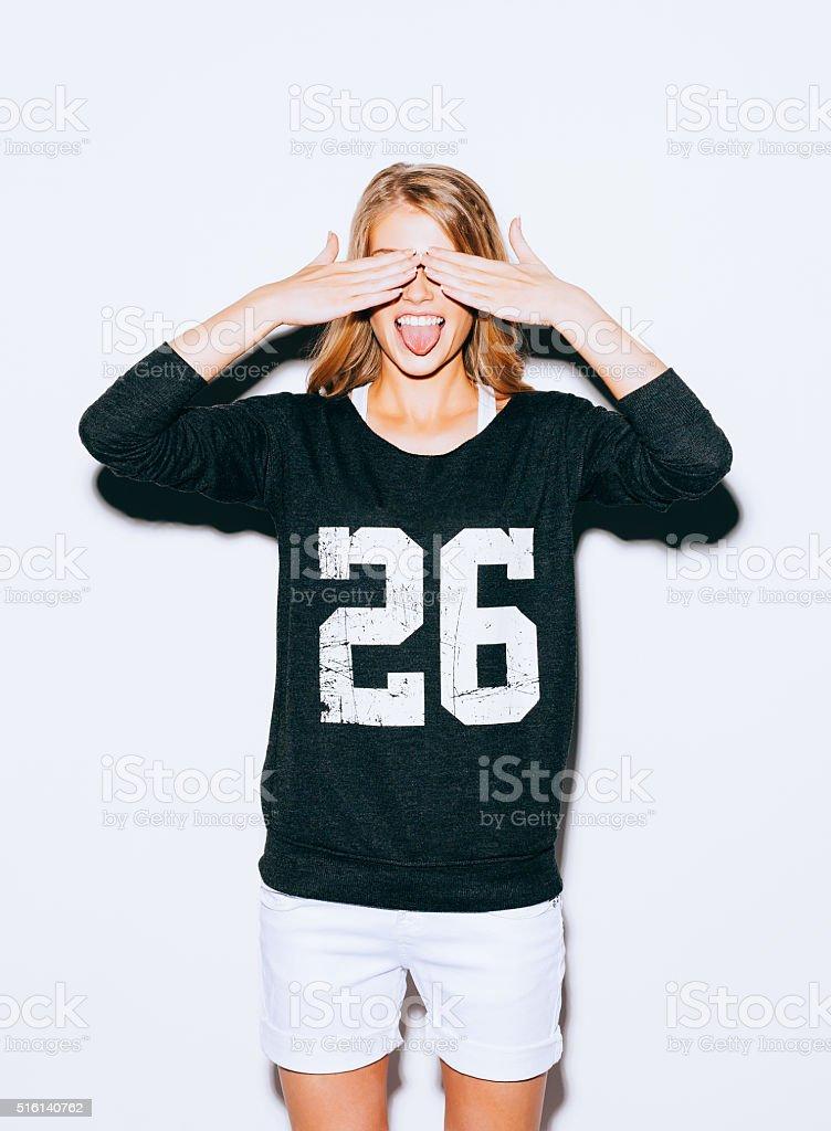 Funny lifestyle portrait beautiful blond crazy girl closes eyes stock photo